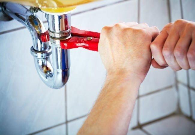 repairing-sink-with-wrench-aquality-plumbing-heating-calgary Plumbing